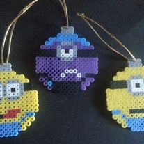 Set of 3 adorable minions ready for your holiday tree, wreath or where ever you want to display your favorite little helpers. These come with a hanging cord in place or not your choice.  I hand-craft these adorable magnets, hanging ornaments, and wall décor in my home. They make fun refrigerato...