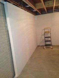 Wahoo Walls is a basement finishing paneling system. It is water and fire resistant, supposedly has an insulation value of and takes care of 4 of the most brutal steps of DIY basement finishing ( (Basement Step Ideas) Basement House, Basement Apartment, Basement Plans, Basement Bedrooms, Basement Stairs, Basement Flooring, Basement Renovations, Home Remodeling, Basement Ideas