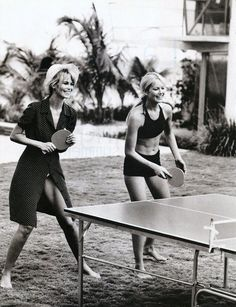 Claudia Schiffer and Valeria Mazza, ping pong, black tunic, bikini. 1995, Harper's Bazaar US. Photographed by Peter Lindbergh
