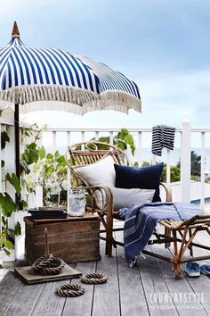 Outdoor living at its best! Blue and white outdoor living space