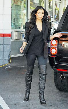 KK in over knee boots and black blazer