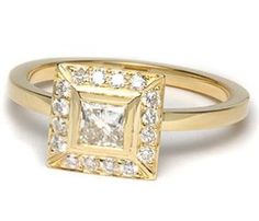 The square-shaped halo diamonds create a beautiful frame around your center diamond. The glimmering 18k yellow gold band and setting provide color and contrast against the diamonds in this engagement ring. Your center diamond can be a princess, radiant, Asscher, or carre shaped diamond.