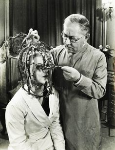 "1934. Max Factor demonstrates his ""scientific device"" the Beauty Micrometer which detects defects in feminine beauty that are imperceptible to the naked eye."