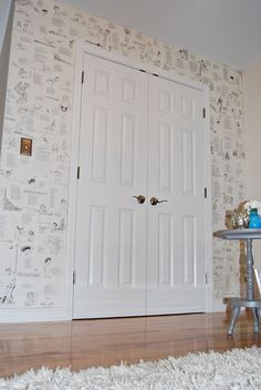 Wallpaper using Shel Silverstein's Falling Up book. She tacked up hardwood flooring paper to the wall first and then just decoupaged the pages to the wall in no particular order. Adorable, interactive, poetic wall paper.