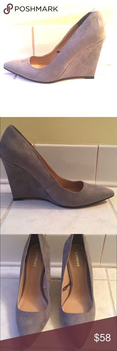 Faux Suede Pointed-Toe Wedge Pump This is a luxurious wedge pump that is perfect for the office and entertaining clients after work!They have a 3 3/4 covered wedge heel. They are a size 7 and true to size. They are in perfect condition and are only being sold because they are too small.l worn them once for a couple hours so there is no wear inside the shoe. There is minimal wear on the soles of the shoe. Very disappointed to let these shoes go since they really accentuated my legs. Contact…