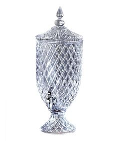 Perfect for bridal showers or elegant evenings, this stunning crystal dispenser displays champagne punch or chilled lemon water with equal sophistication. The convenient self-serve spout allows guests to refill their glasses easily.19.5'' H x 7.5'' diameterHolds 1.5 gal.CrystalHand wa...
