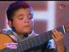 "Julio Silpitucla - La cumparsita""  He looks about 7 years old."