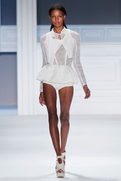 White perforated super piqué cropped vest over white textured gauze long sleeve pullover with white super piqué boy shorts.
