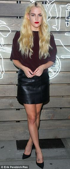 Ladies in leather: Riley Keough, left, wore a tight black mini skirt, as Kelly Rohrbach, r...
