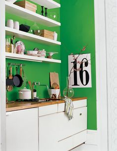 You've been toying around with the idea of a bright wall - and it's finally time to take the plunge! A vibrant hue sets the scene in this modern kitchen space.