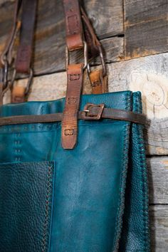 7cd440b21 CIBADO leather bags Entirely hand sewn teal buffalo leather tote  incorporating vintage horse tack to become
