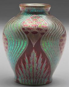 Zsolnay vase, iridescent dark red, green and gold, eosin-glaze decorated earthenware, floral and geometric patterns. Zsolnay pottery was made in Hungary after 1862 and is characterized by Persian, Art Nouveau, or Hungarian motifs.