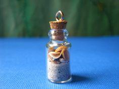 Mini Wrightsville Beach in a Bottle Seashell Pendant. $8.00, via Etsy.
