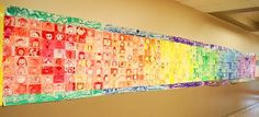 First day back to school!  Each class does a portrait of themselves in a different color.  Use crayons, pencils etc.  Display like the color wheel!