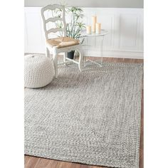 Quality meets value in this beautiful modern area rug. Handmade with polypropylene to prevent shedding, this braided area rug will enhance any home decor. Pile Height: 0.25 - 0.5 inch Material: Polypr