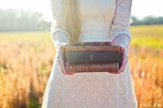 Yaaay for old books, pretty dresses, fields, and sunlight :D. And Allix B. who took this of me :D. allixbphotography.com