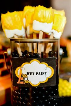 Marshmallow wet paint brushes---Square marshmallows dipped into yellow candy melts look a lot like wet paint brushes!
