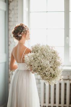 Oversized baby's breath bridal bouquet ⎪ Antonova Kseniya Photography ⎪ see more on:  http://burnettsboards.com/2015/04/spring-nature-bridal-portraits/