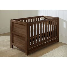 Tutti Bambini Milan Cot Bed-Walnut  Description: The Milan is a stylish yet sturdy cot bed which can be easily converted into a junior bed or a sofa bed ? this makes it a great piece of furniture that can adapt as your little one grows. For extra storage, the Milan also comes with an under-cot drawer on wheels. Features: Suitable...   http://simplybaby.org.uk/tutti-bambini-milan-cot-bed-walnut/