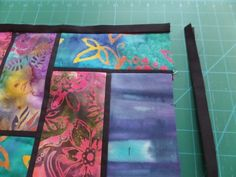 Sew sashing to the sides of the stained glass quilt