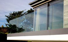 Frameless Glass Balustrade give unhindered views to any decking, garden or balcony area, Camel offer a a full advice design and Installation service. Frameless Glass Balustrade, House With Balcony, Glass Balcony, Exterior Doors With Glass, Pergola Attached To House, Small Pergola, Apartment Balconies, Apartments, Pergola Curtains