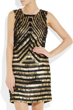 GUCCI  Metallic-striped fringed leather dress  $5,900