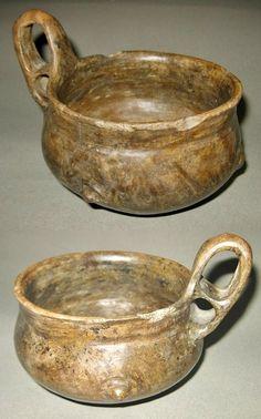 Villanovan Impasto Ware Vessel  CULTURE / REGION OF ORIGIN: Villanovan Culture, Italy (Northern Lazio or Southern Etruria)) DATE:  8th – 7th Century BCE DIMENSIONS: Maximum height with handle 11 cm (4.3 in.); maximum width 13.1 cm (5.1 in.); rim diameter 12.0 cm (4.7 in.)