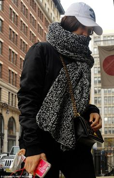 Low profile: The 20-year-old model hid behind a scarf as she stepped out in sporty gear in the Big Apple