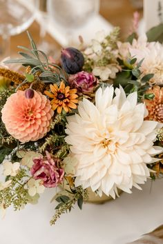 Autumn centerpiece with figs, persimmons, rosemary, and lavender along with dahlias.  Grown and designed by Love 'n Fresh Flowers.  Photo by Maria Mack Photography.