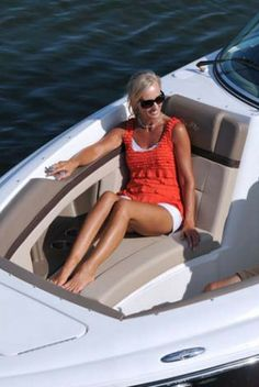 Sea Ray 270 SLX: The recumbent bow seating now features arm rests. Look at the details: padded bolsters/backrests, contoured seats, multi-colored upholstery, courtesy lights, walkthrough door, twin drink holders, handhold, and a large anchor locker with ss latch.
