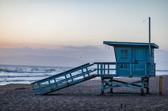 Off-Duty.   Just after watching the sun set on the first day of my destination engagement session I captured this image. I have always felt that these lifeguard towers are quintessential California. While we were exploring the boardwalk during the day we watched as the lifeguards were training -- let me tell you it was intense! The seas were ripping and they had to swim out past the breakers around a buoy back in and then run all the way to the start of the beach and back for who knows how…