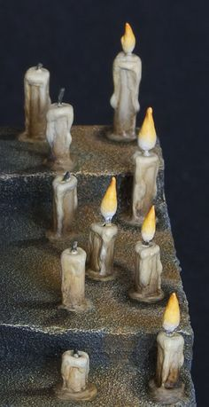 Twisted Brushes: Candles Making and painting candles for miniature bases and displays.