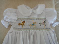 Hand Smocked Girls Dresses....... Size showing is 3 years ............Looks gorgeous ......... The Dress has been created in a poly cotton fabric in a Blue colour..............It has a Peter Pan collar..............The back has 3 buttons with sash....... ........The first 3