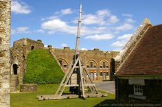 Medieval Trebuchet near Godsfoe Tower, the Devil's Tower, in Dover Castle, Kent, England, UK. Catapult siege engine moved here from Keep Yard in 2010. Godsfoe Tower and steps to Crevecouer Tower on left; Napoleonic Wars Spur Casemates behind; Stables right. Trebuchet used in French Siege of Dover Castle, AD 1216-1217 (First Barons War). Listed Building, English Heritage site, and Scheduled Ancient Monument. Norman and Medieval History. More information at http://www.panoramio.com/photo/34753...