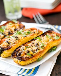 Chipotle Black Bean Stuffed Squash- The taste is sweet and tender, like a sweet potato, and you can even eat the skin