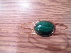 Malachite gemstone mounted on a Gold Plated Bracelet