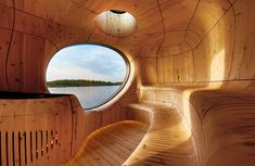 Grotto Sauna with a Curved Wood Interior by PARTISANS