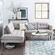 Mid Century Modern Living Room Decor Paired With Industrial Round Coffee Table Metal Base And Modern L Shaped Sectional Sofa