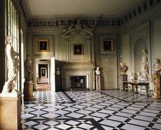Room view of the Marble Hall at Petworth towards the frieze of acanthus brackets with the Duke of Somerset's heraldic beasts over the chimneypiece
