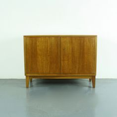 Product code: 2099  Handy size beech vintage midcentury credenza made by WK Mobel.    In good vintage condition.   Approximate dimensions:  Height: 67cm  Width: 90cm  Depth: 35cm  Inside: 45cm H x 32cm D x 85cm W.