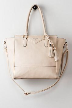 From Francesca's Boutique: http://www.francescas.com/product/harper+tassel+tote+in+ivory.do?sortby=ourPicks