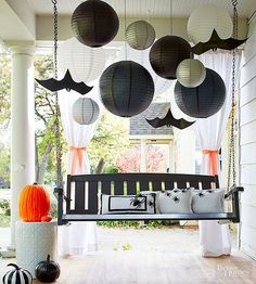 A cute and clever collection of crafts and party basics lends this front porch an enviable sense of Halloween style. Make the Halloween craft: Paper lanterns -- black, silver, and white -- hung at alternating heights offer visual interest and a backdrop t