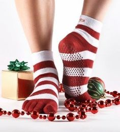 ToeSox Yoga-Pilates Toe Socks with Grips, Medium, Holiday Red Stripe by ToeSox. $15.00. ToeSox unique five- toe design allows the entire foot to perform naturally, encouraging the toes to separate and activate the muscles in the feet. Toe socks increase dexterity and tactile sensitivity and awareness during any activity. Toe socks help strengthen the muscles of your feet allowing for overall better circulation, balance and posture. The original ToeSox, with the patented n...