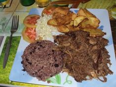 Cuban roast pork with black beans and rice