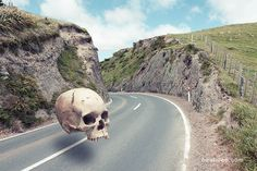 Surreal floating skull over a New Zealand road, by Joseph Westrupp, bestilled.com. Title: Cranium Impedimentum. Fine art prints available at website.