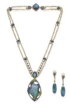 A SUITE OF BLACK OPAL, SAPPHIRE AND DEMANTOID GARNET JEWELRY, BY LOUIS COMFORT TIFFANY FOR TIFFANY & CO., circa 1910, necklace 19 ins.  Signed Tiffany & Co.