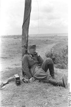 """A German officer uses telecommunications during """"operation Barbarossa"""" 3 July 1944."""