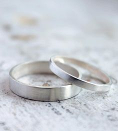 simple his and her silver wedding bands