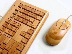 Fancy - Bamboo Keyboard & Mouse by Impecca...okay, that IS pretty sweet looking...