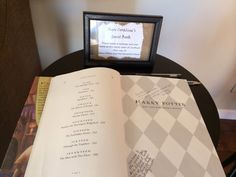 The Hinton Haven: Harry Potter Baby Shower    Guest book is baby's first Harry Potter signed by guests.